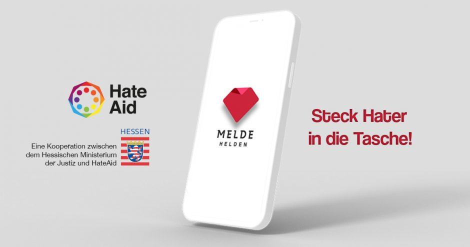 """Das Logo der MeldeHelden-App auf einem weißen Handy mit dem Spruch """"Steck Hater in die Tasche!"""""""