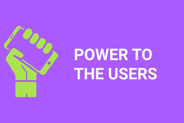 Grüne Faust mit Smartphone und Schrift Power to the Users